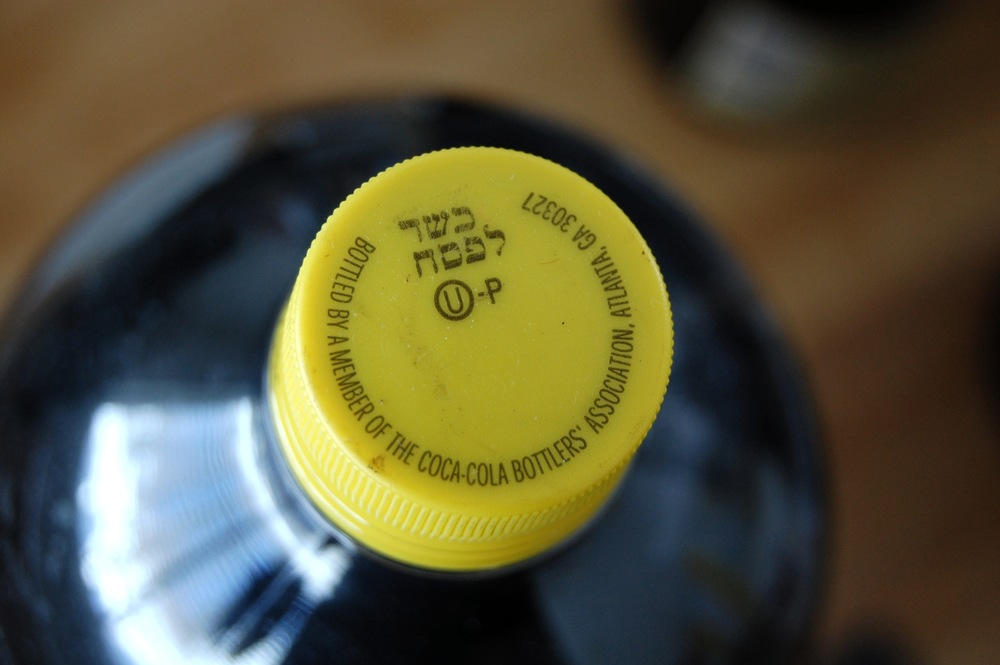 Click photo to download. Caption: A kosher-for-Passover bottle of Coca-Cola, distinguished from ordinary Coca-Cola bottles by its yellow cap. Credit: Mark H. Anbinder via Flickr.com.