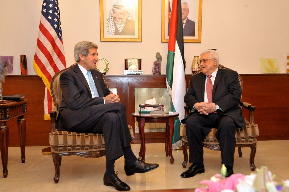 Click photo to download. Caption: U.S. Secretary of State John Kerry (left) sits with Palestinian Authority President Mahmoud Abbas before a meeting in Amman, Jordan, on June 28, 2014. Kerry and Abbas had their latest meeting, also in Amman, on Feb. 21, 2016. Credit: U.S. Department of State.