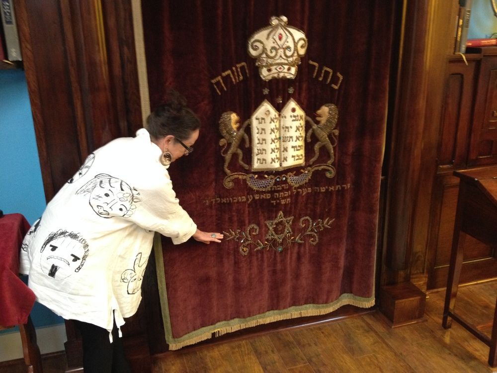 Click photo to download. Caption: Kathleen Sukiennik, former executive director of Congregation Beth Jacob of Galveston, Texas, shows the water line on the synagogue's Torah ark, a reminder of the devastation wrought by Hurricane Ike in 2008. Credit: Jacob Kamaras.