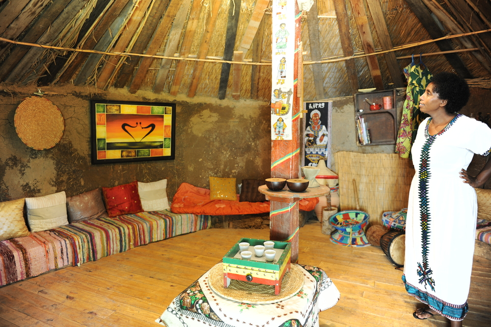 Click photo to download. Caption: Yoney Skiba, one of the enterprising Israeli women whose projects were adopted by the Treasures of the Galilee group, in her Ethiopian hut on Kibbutz Evron. Credit: Courtesy Treasures of the Galilee.