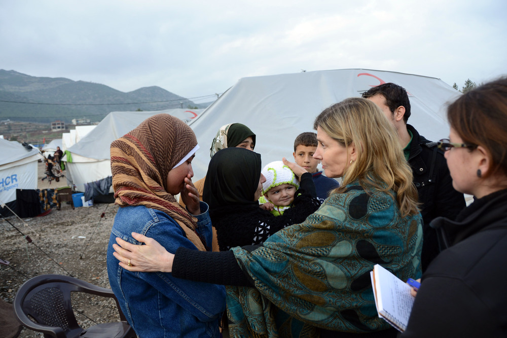 Click photo to download. Caption: Nancy Lindborg—USAID's assistant administrator for democracy, conflict, and humanitarian assistance—interacts with Syrian refugees at the Islahiye Refugee Camp in Turkey on Jan. 24, 2013. Credit: State Department.