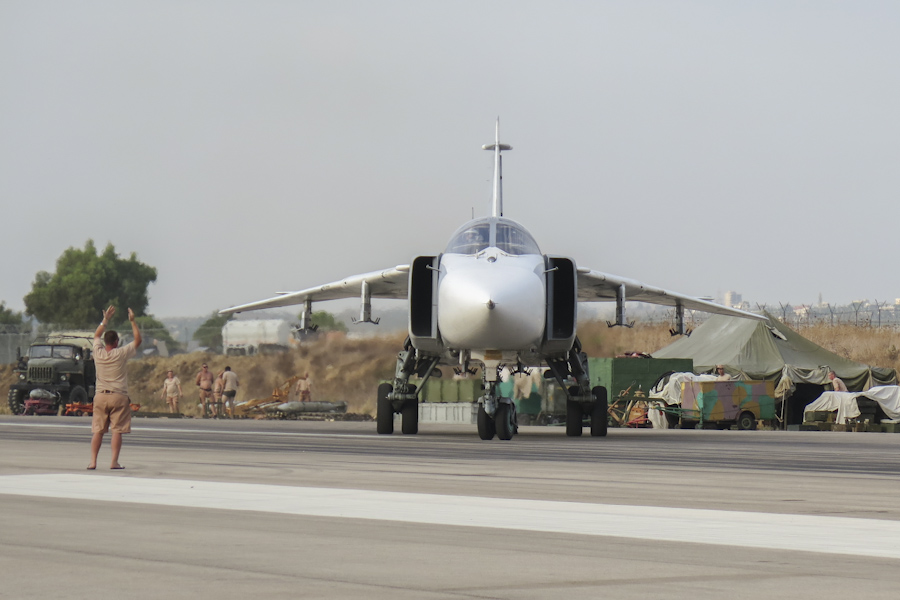 Click photo to download. Caption: A Russia Sukoi Su-24 fighter jet in Latakia, Syria. Credit: Wikimedia Commons.