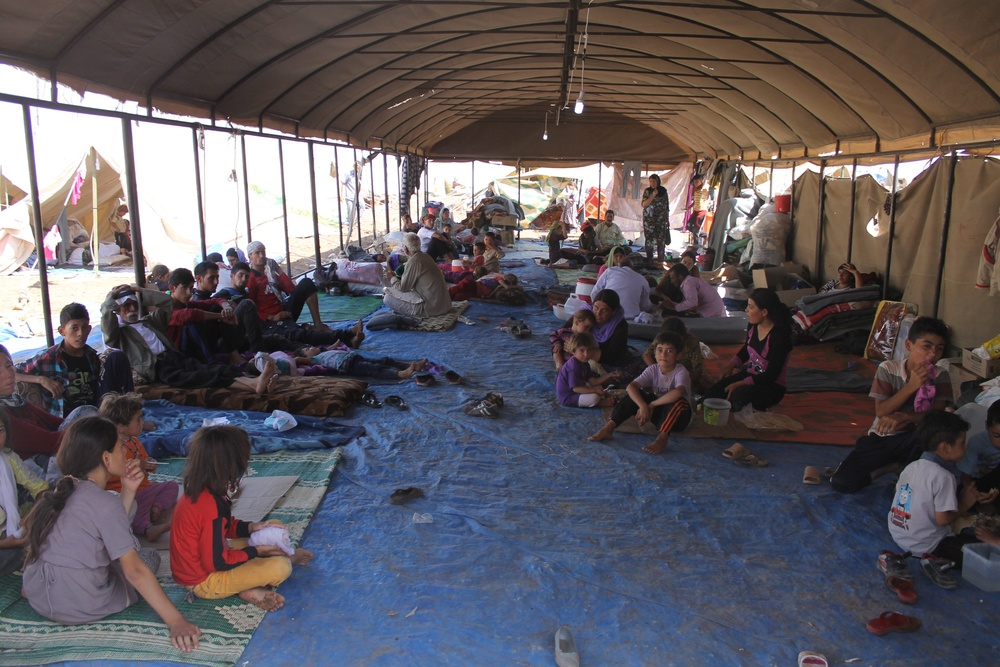 Yazidi refugees who escaped Islamic State militants receive support from the International Rescue Committee on August 13, 2014. Credit: Rachel Unkovic/International Rescue Committee via Flickr.com.