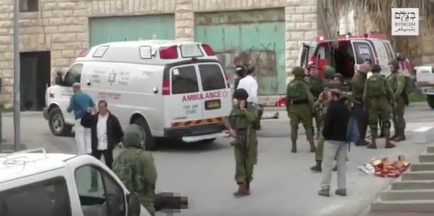 Israeli officials condemned an IDF soldier for an incident shown here in this video screenshot, in which the soldier shot a Palestinian terrorist who was already incapacitated on the ground. Credit: Screenshot via YouTube.