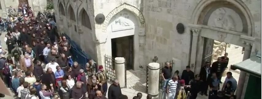 Christian pilgrims take a procession through Jerusalem's Old City for Good Friday. Credit: YouTube screenshot.