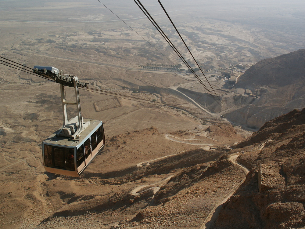 Click photo to download. Caption: A cable car ascending the Masada fortress, one of Israel's most popular tourist destinations. Credit: K.Szajowski via Wikimedia Commons.