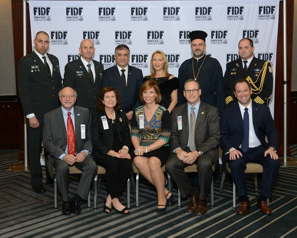 Click photo to download. Caption: Pictured at the March 28 Friends of the Israel Defense Forces Texas Region gala: (back, from left) IDF Brig. Gen. Muni Katz; IDF Lt. Col. David Sonego; FIDF National Director and CEO Maj. Gen. (Res.) Meir Klifi-Amir; Brig. Gen. (Res.) Gila Klifi-Amir; Father Gabriel Naddaf; and IDF Capt. Gil Aginsky; (front, from left) FIDF Texas Region Gala Dinner chairs Bennet and Robin Greenspan as well as Susan and Max Reichenthal; and FIDF Texas Region Executive Director Scott Kammerman. Credit: Alan Ross.