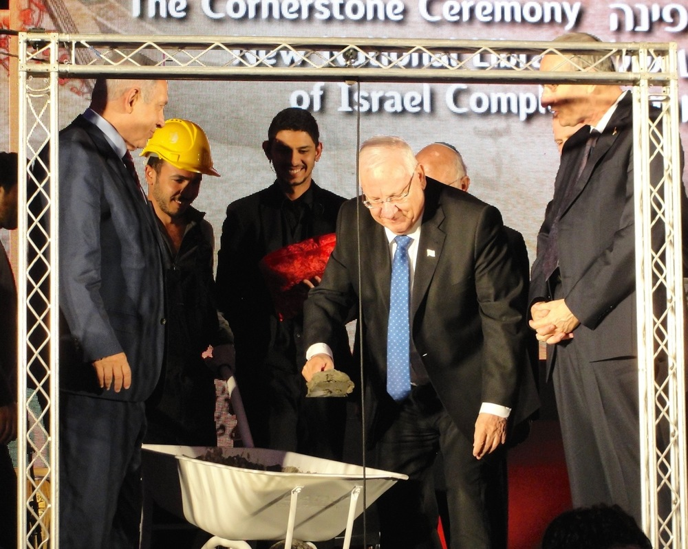 Click photo to download. Caption: Israeli President Reuven Rivlin breaks ground on the new National Library of Israel building as Israeli Prime Minister Benjamin Netanyahu (far left) looks on. Credit: Judy Lash Balint.