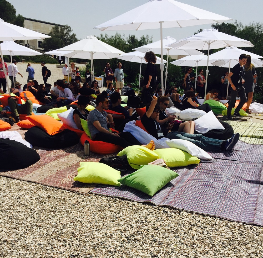Click photo to download. On April 6 in Israel, attendees sit on bean bag chairs at the first-ever Forbes Under 30 EMEA (Europe, the Middle East, and Africa) summit. Credit: Maayan Jaffe-Hoffman.