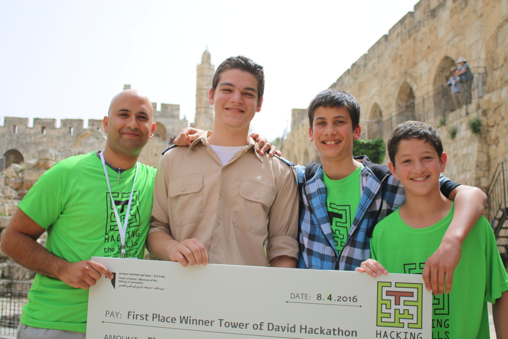 "Click photo to download. Caption: The first-prize winners of the ""Hacking the Walls"" event at the Tower of David Museum in Jerusalem, including (at left) Royi Elbag of ARCH as well as the youth team of 12th grader Malachi Shneor and 9th graders Ofer Stolev and Yuval Goldshmidt. Credit: Courtesy Tower of David Museum."