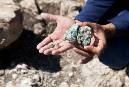 Archaeologist Abdel Al-Salam Sa'id holds up one of the chunks of glass discovered at the site of the kilns in northern Israel. The findings proved that Israel was a leader in Roman-era glass making. Credit: Assaf Peretz/Israel Antiquities Authority.