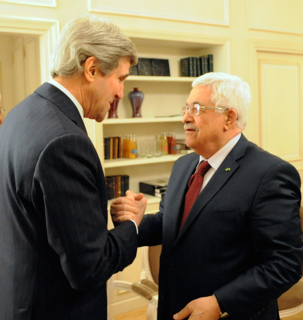 Click photo to download. Caption: U.S. Secretary of State John Kerry (left) and Palestinian Authority President Mahmoud Abbas shake hands before a meeting in Paris on Feb. 19, 2014. Credit: U.S. Department of State.