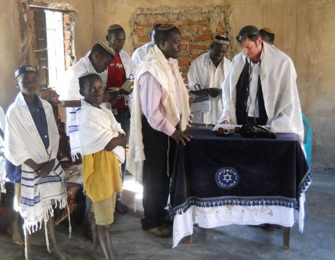 Members of the Abayudaya Jewish community pray in a synagogue near Mbale, Uganda. Credit: Moshe Cohen via Wikimedia Commons.