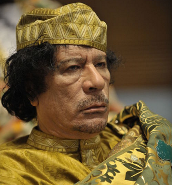 Former Libyan dictator Muammar al-Gaddafi. Credit: U.S. Navy photo by Mass Communication Specialist 2nd Class Jesse B. Awalt via Wikimedia Commons.