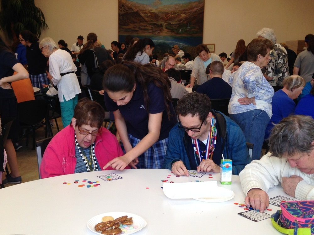 Click photo to download. Caption: At the Jewish Association of Residential Care's Living and Learning Center for adults with developmental disabilities in Boca Raton, Fla., residents are treated to a game of Bingo with students from Katz Hillel Day School. Credit: Courtesy Katz Hillel Day School.