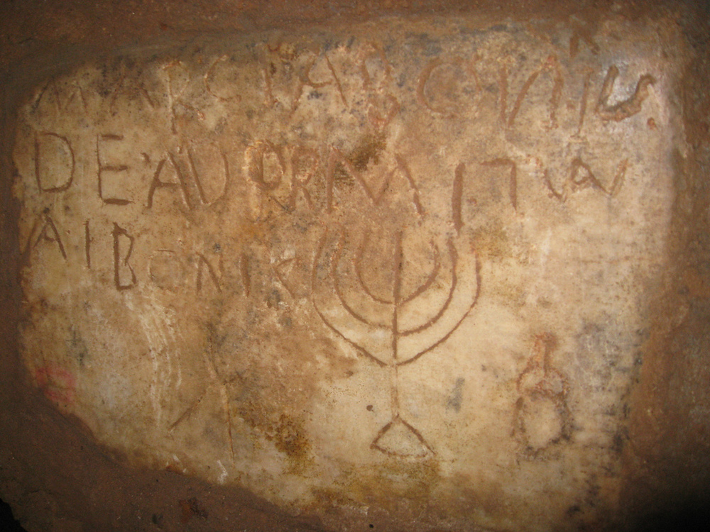 An inscription of a menorah in the Jewish catacombs of Rome. Credit: Wikimedia Commons.
