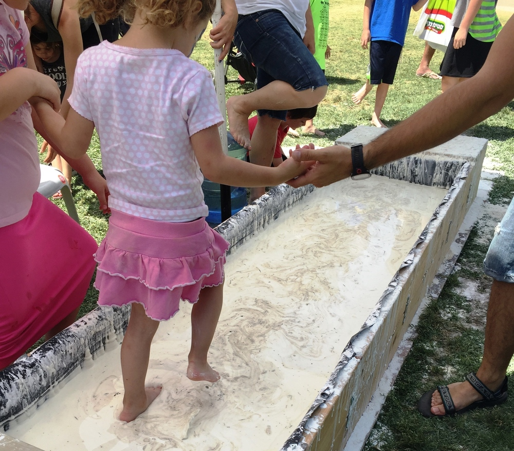 Click photo to download. Caption: At Jerusalem's Geek Picnic, children experienced the closest thing to walking on water—walking across this shallow pond made of corn starch and water. Credit: Maayan Jaffe-Hoffman.