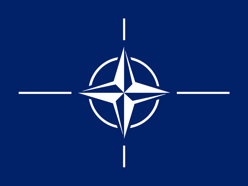 The flag of NATO. Credit: Wikimedia Commons.