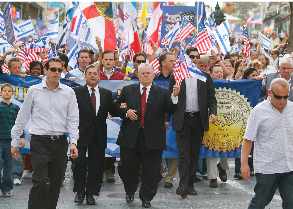Click photo to download. Caption: A Christians United for Israel (CUFI) solidarity march in Jerusalem in 2010. In center in front of the banner, holding American and Israeli flags, is CUFI founder Pastor John Hagee. Credit: CUFI.