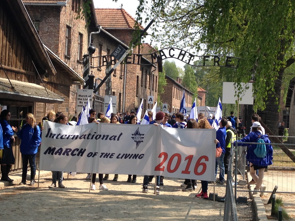 Click photo to download. Caption: The start of the 2016 March of the Living from Auschwitz to Birkenau. Credit: Jacob Kamaras.