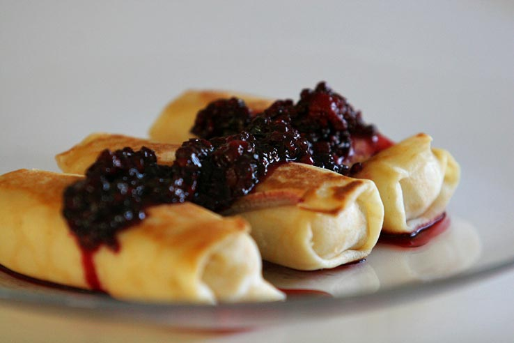 Click photo to download. Caption: Cheese blintzes topped with blackberries. (Illustrative photo.) Credit: Susanica Tam via Wikimedia Commons.