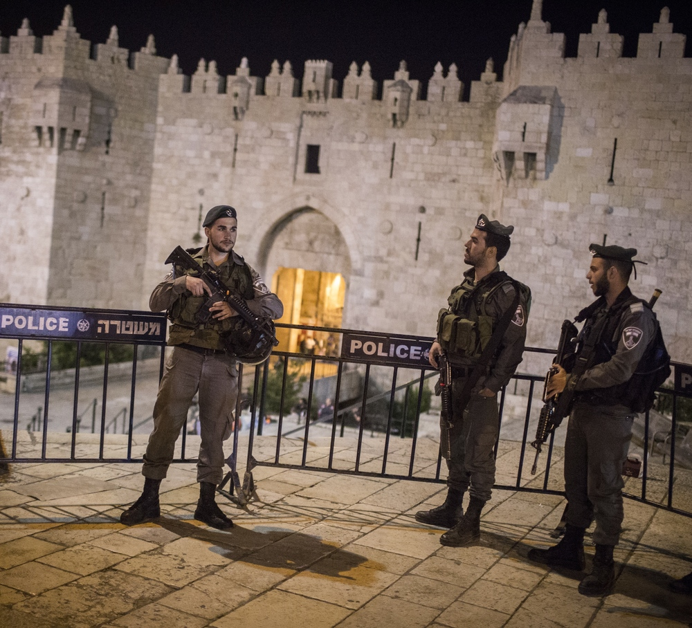 Click photo to download. Caption: Israeli Border Police officers guard at the Damascus Gate as security forces shut down Jerusalem's Old City while searching for a suspect following a stabbing attack on May 2, 2016. Credit: Hadas Parush/Flash90.