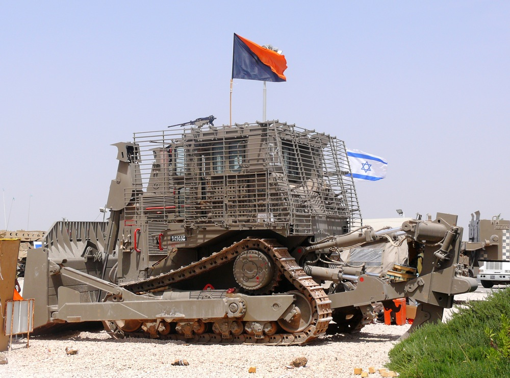 "Click photo to download. Caption: An IDF Caterpillar D9 bulldozer. In calling for a boycott of Caterpillar—long a target of the anti-Israel BDS movement—Dalit Baum speaks of the bulldozers' use to ""raze Palestinian homes [and] construct the separation barrier,"" ignoring the fact that the demolished buildings were being used to shield attacks or belonged to terrorists who murdered innocent civilians, writes Robin Joshowitz. Credit: MathKnight via Wikimedia Commons."