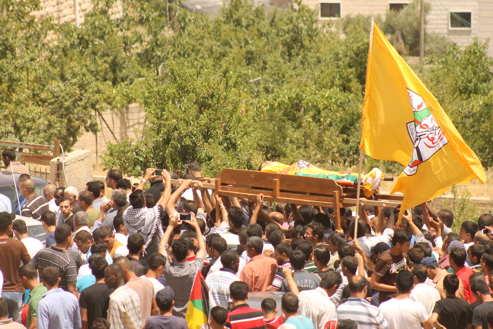 A funeral in the disputed Palestinian territories in June 2014. (Illustrative photo.) Credit: Azzam Talahmi via Wikimedia Commons.