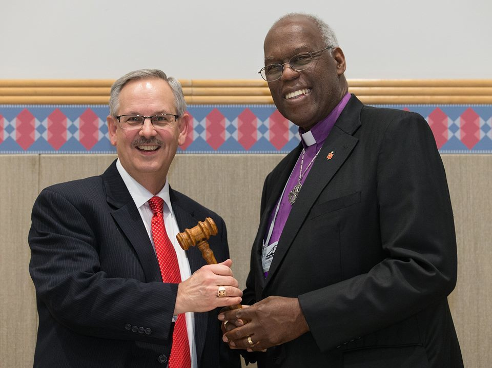 Click photo to download. Caption: The ceremonial passing of the gavel from outgoing United Methodist Church (UMC) Council of Bishops president Bishop Warner H. Brown, Jr. (at right) to the council's new president, Bishop Bruce R. Ought, during the UMC's quadrennial general conference in Portland, Ore., in May 2016. Credit: Mike DuBose/United Methodist News Service via Facebook.