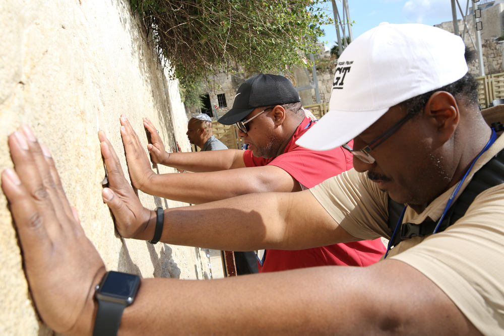 Click photo to download. Caption: Leaders of the National Baptist Convention of America visit the Western Wall in Jerusalem during a May 23-29 trip organized by the International Fellowship of Christians and Jews. Credit: Olivier Fitoussi.