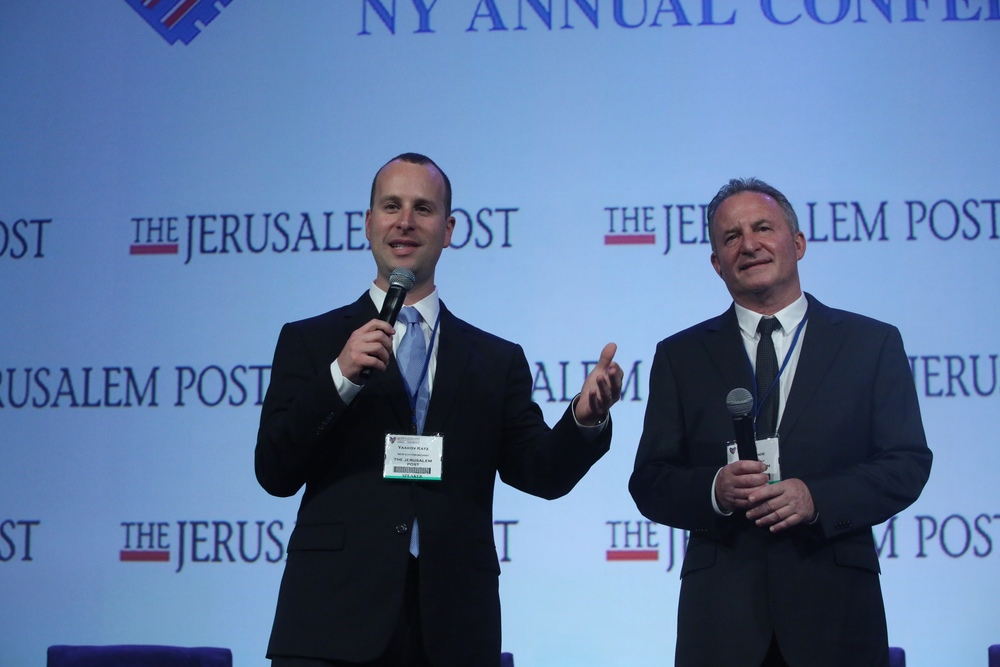 Click photo to download. Caption: New  Jerusalem Post  Editor-in-Chief Yaakov Katz (left) with outgoing editor-in-chief Steve Linde on stage at the newspaper's fifth annual conference last month in New York City. Credit: Marc Israel Sellem.