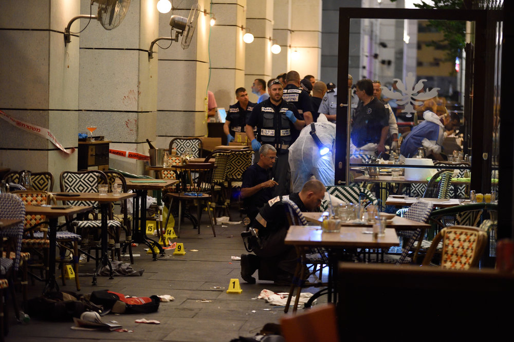 Click photo to download. Caption: Israeli security forces at the scene where Palestinian terrorists opened fire and killed four people at the Sarona market in Tel Aviv on June 8. Credit: Gili Yaari/Flash90.