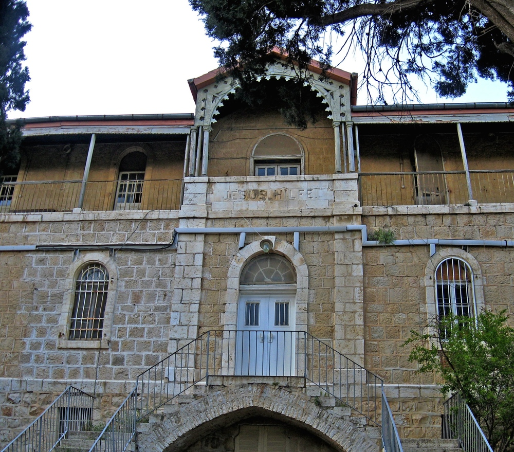 Click photo to download. Caption: The Hansen House in Jerusalem. Credit: Tamar Hayardeni via Wikimedia Commons.