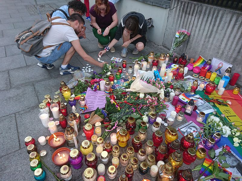 Click photo to download. Caption: A memorial display for the Orlando shooting victims in Warsaw, Poland. Credit: Wikimedia Commons.