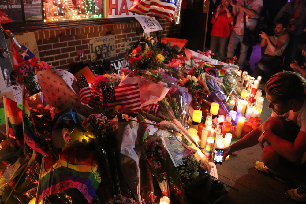 Click photo to download. Caption: A vigil for the victims of the Orlando nightclub shooting in New York City. Credit: Elisa S via Wikimedia Commons.