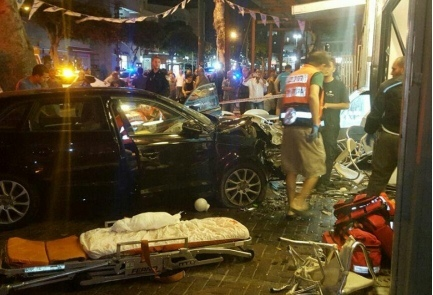 The scene of Saturday night's deadly car accident in Tel Aviv. Credit: Assaf Barzinger/Magen David Adom.
