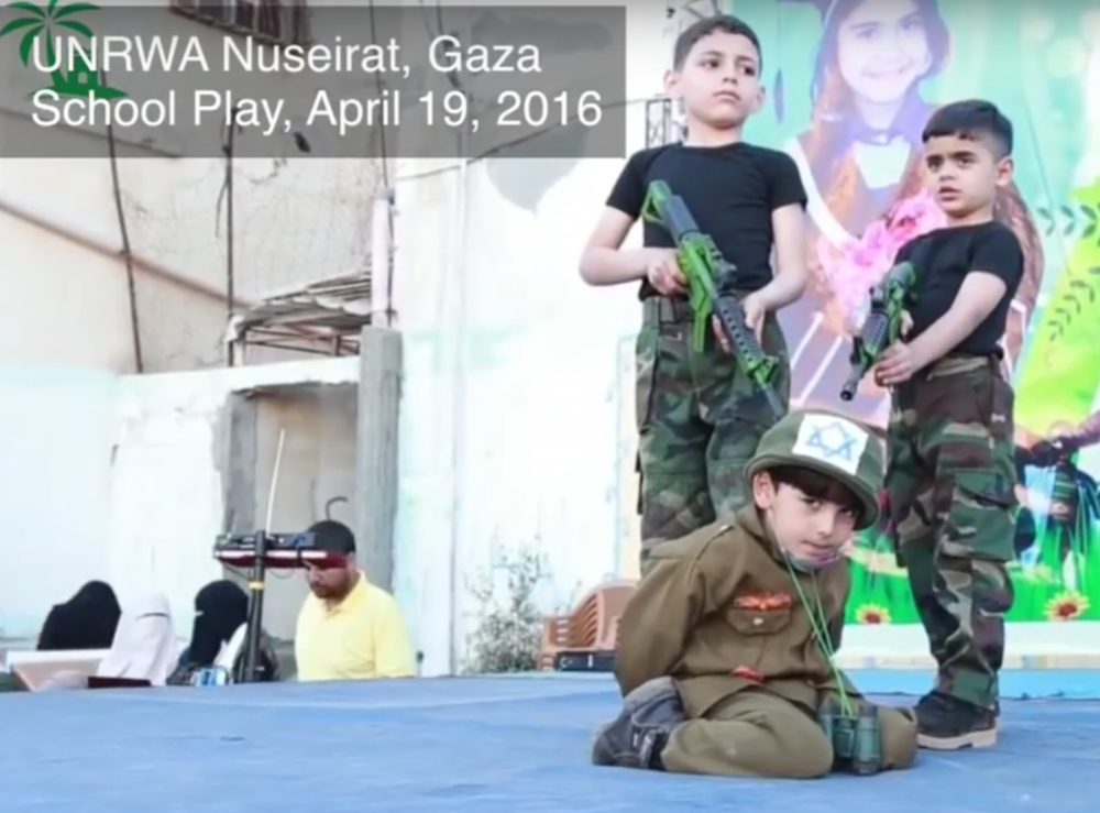 Click photo to download. Caption: A military-themed school play held in April 2016 at the UNRWA Nuseirat School in Gaza, in which students hold an Israeli hostage at gunpoint. Credit: Center for Near East Policy Research.