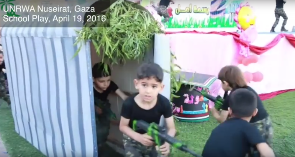 Click photo to download. Caption: A military-themed school play held in April 2016 at the UNRWA Nuseirat School in Gaza, in which students emerge from a tunnel to carry out an attack against Israelis—mirroring the Hamas terror group's cross-border attack tunnels. Credit: Center for Near East Policy Research.