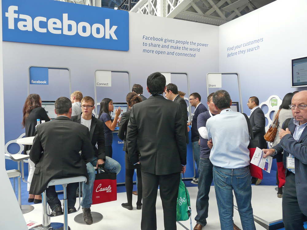Click photo to download. Caption: A Facebook booth at a conference in the United Kingdom. Credit: Derzsi Elekes Andor via Wikimedia Commons.