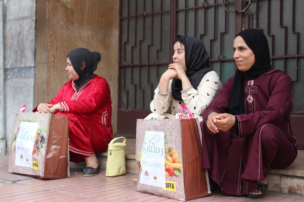 Three Moroccan-Muslim women sit with their Ramadan gift bags containing food, which they received from the International Fellowship of Christians and Jews, Chabad, and Mimouna. Credit: Jeunesse Chabad Maroc.