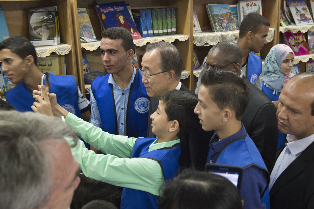 "Click photo to download. Caption: On June 28, 2016, United Nations Secretary-General Ban Ki-moon (in center) visits Gaza's Al-Zeitoun School, which is run by the U.N. Relief and Works Agency for Palestine Refugees in the Near East (UNRWA). For Ban's visit, school officials covered up a large map showing all of Israel as ""Palestine."" Credit: U.N. Photo/Eskinder Debebe."