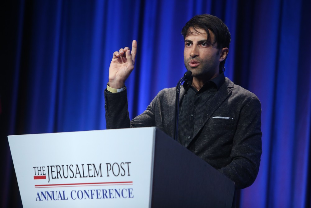 "Click photo to download. Caption: ""Green Prince"" Mosab Hassan Yousef, the son of Hamas terror leader Sheikh Hassan Yousef, speaks at the Jerusalem Post newspaper's annual conference in New York City on May 22, 2016. Credit: Marc Israel Sellem."