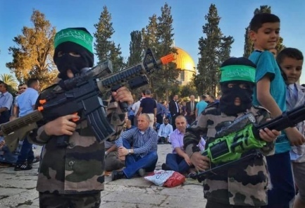 Palestinian youth posing as Hamas terrorists on Temple Mount. Credit: Lach Yerushalayim.