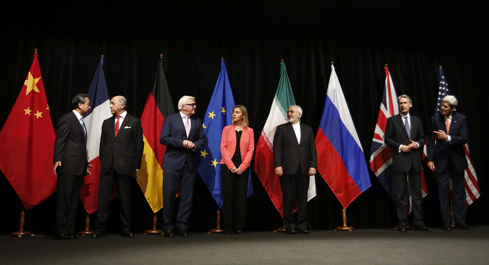 Click photo to download. Caption: On July 14, 2015, foreign ministers and secretaries of state are pictured in Vienna, Austria, upon the announcement that Iran and the P5+1 nations had reached an agreement on Iran's nuclear program. From left to right: Wang Yi (China), Laurent Fabius (France), Frank-Walter Steinmeier (Germany), Federica Mogherini (European Union), Mohammad Javad Zarif (Iran), Philip Hammond (United Kingdom), and John Kerry (United States). Credit: Bundesministerium für Europa, Integration und Äusseres via Wikimedia Commons.