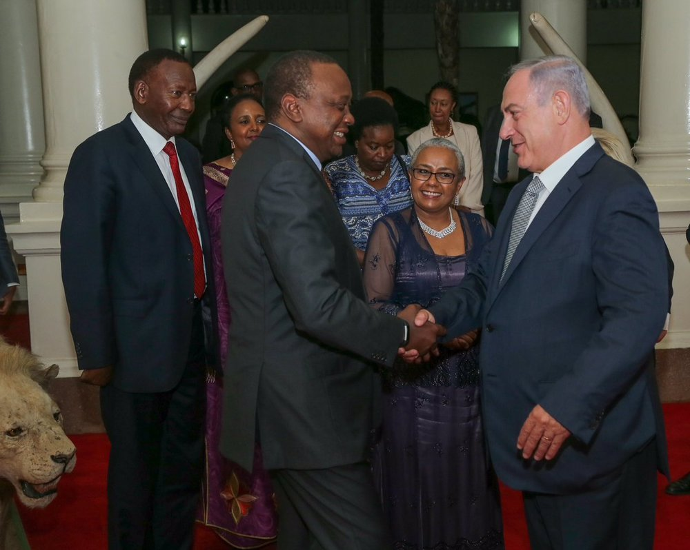 Israeli Prime Minister Benjamin Netanyahu shaking hands with Kenyan President Uhuru Kenyatta during a visit to his country. Credit: Twitter.