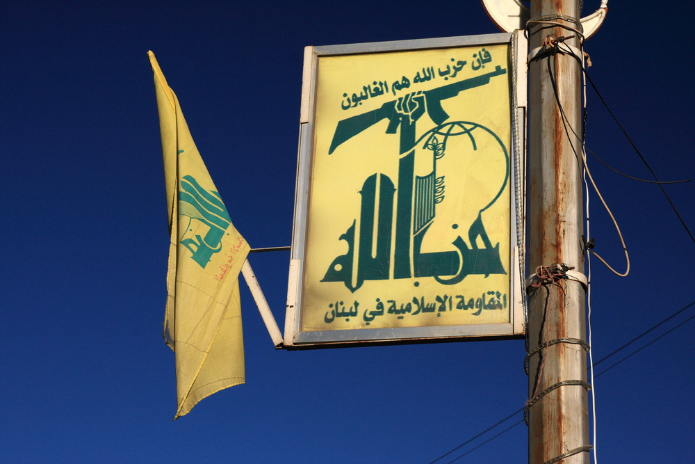 Click photo to download. Caption: Hezbollah flags in Baalbek, Lebanon. Credit: Wikimedia Commons.