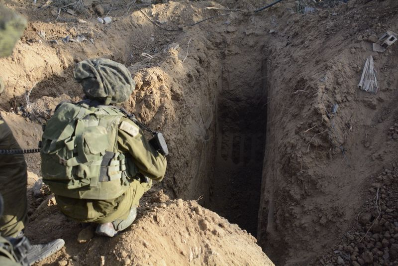 An Israel Defense Forces soldier overlooks an uncovered Hamas terror tunnel during Operation Protective Edge in 2014. Credit: IDF.