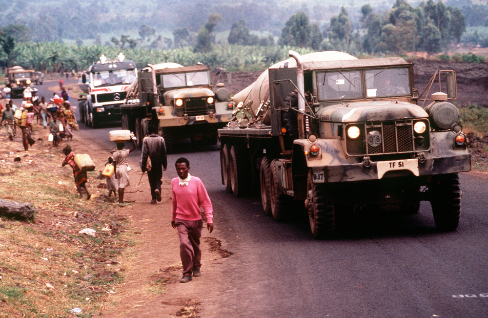 A convoy brings fresh water to Rwandan refugees located at Camp Kimbumba, Zaire i August, 1994. Credit:  TSgt. Marc Krause via Wikimedia Commons.