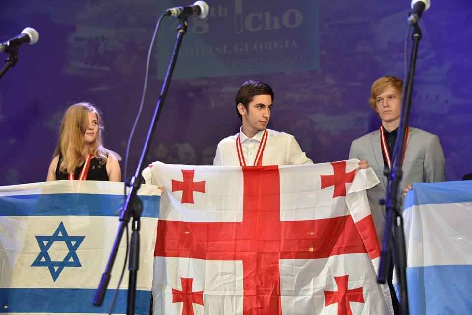 A member of the Israeli team holds up her country's flag at the closing ceremony of the International Chemistry Olympiad in Tbilisi, Georgia. Credit: Facebook.