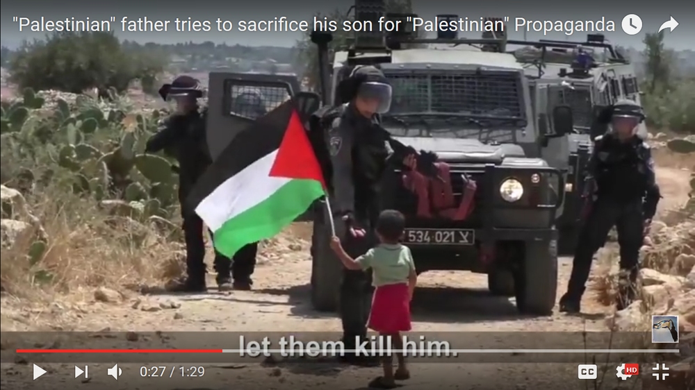 Palestinian father pushes son toward Israeli soldiers taunting them to kill his son; soldier high-fives boy. Credit: IsraelFullTruth via YouTube.